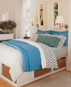 Small Place Style: Love the baskets under the bed!