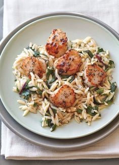 Chard stirred into rice-shaped pasta gives this risotto-like dish a vegetable component and transforms it into the perfect base for quickly browned sea scallops. The quick pan sauce gains bright…
