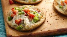 Rotisserie chicken, veggies and ranch dressing make great mini pizzas.
