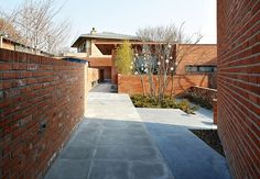 Image 12 of 31 from gallery of Fortress Brick House / Wise Architecture. Photograph by Roh Kyung Brick Architecture, Architecture Photo, Outdoor Spaces, Outdoor Decor, Being A Landlord, The Neighbourhood, Scenery, Sidewalk, Exterior