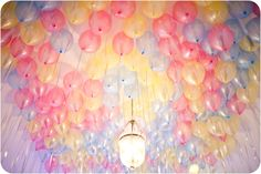 Do white balloons with ribbon and white coffee filter flowers hanging down....easy to remove after wedding.