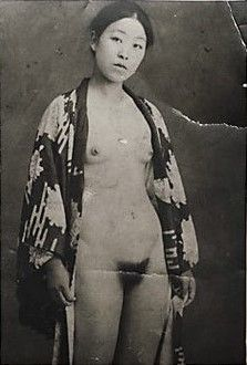 Not a Korean comfort woman enslaved by Japanese Troops during WWII, (wild imagination) but an erotic vintage postcard of a Japanese woman wearing a juban, an undergarment worn beneath a kimono.