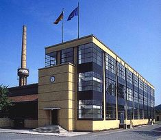 """RATIONAL/FUNCTIONAL: Fagus Shoe Factory, Alfeld-an-der-Liene, Germany, Walter Gropius and Adolph Meyer (1911): Gropius' """"etherealization"""" is evident here, his fascination with lightness is seen in the windows.  Slender (and lighter coloured) verticals and thicker horizontals emphasise the openness of window openings.  Note, the construction was not executed particularly well, the foundations are of mixed pebble concrete, not reinforced by steel.  Floors were not braced for shear."""