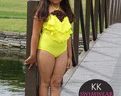 Pretty little girls one piece swimwear. Yellow with brown flowers. Sizes 2-12