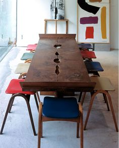 Edmund Sumne --- love this long table, perfect for a conference or a dinner setting. The colorful stools are a great addition of color to a room.