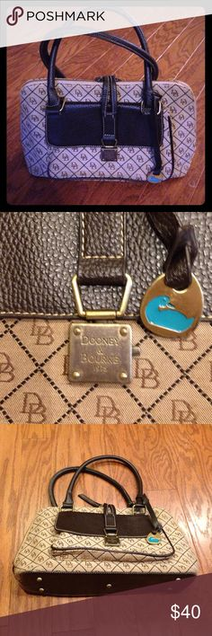 Dooney and Bourke brown purse Great Dooney and Bourke shoulder bag. Brown leather and fabric with DB logos. Wide zippered opening with fold over strap. Staining on the bottom of the inside as pictured, otherwise like new! Dooney & Bourke Bags Shoulder Bags