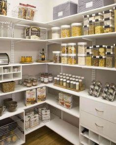 A mix of shelves and drawers filled with stackable clear containers, clever spice storage and pull-out baskets make for a functional and organised pantry