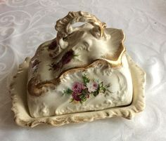 Antique cheese dish collects lots of dust