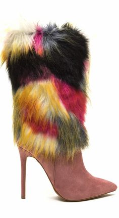 Play Fur Keeps Pointy Boots. Vegan suede boots feature a pointed toe box and a plush fur-trimmed shaft. Finished with a wrapped stiletto heel, a ridged sole, and a full-length side zipper for easy on and off. (affiliate)