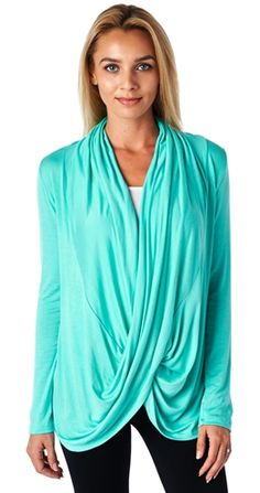 This gorgeous wrap is one of our best sellers and its little wonder why. The perfect cardigan for staying classy and comfy at the office or the soccer field with the kids; the possibilities are endless! The draping front won't flap open as both sides are sewn into the seams. The light weight fabric, fantastic colour options, and casual elegance make this an excellent staple for any wardrobe! Awesome bonus? This top is breastfeeding friendly; offering nursing mommas an easy and stylish…