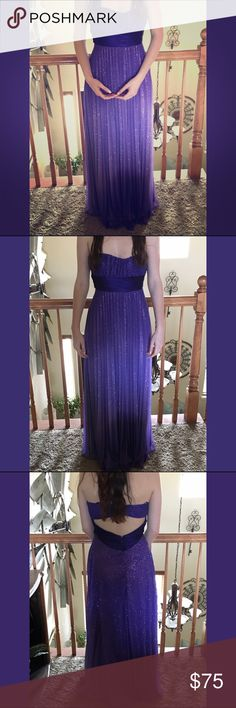 Sparkling Prom dress Purple sparkling prom dress. Never worn, perfect condition. Strapless, ribbon around midsection, begins flowing beneath. Twirls around when spun. Size listed as small, could be worn as a larger size. Bust is much bigger than expected, main reason it's being sold is that it continuously slid down(model is C-cup, bust too big. Model is also 5'8). Zipper on back, a part that hooks together is above. Dresses Prom