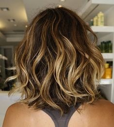 Sexy cut and pretty color.....LOVIN all the tousled waves of this season of hair. Might be my own next cut, yet dark with caramel and deep wines....