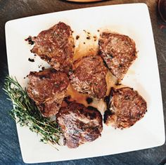 Herb Roasted Lamb Chops  4 large garlic cloves, pressed 1 tablespoon fresh thyme leaves, lightly crushed 1 tablespoon fresh rosemary leaves, lightly crushed 2 teaspoons coarse kosher salt 2 tablespoons extra-virgin olive oil, divided 6 1 1/4-inch-thick lamb loin chops