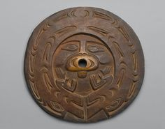 Spindle Whorl (Sulsultin)  Culture: Chemainus, Coast Salish, Native American  Medium: Hardwood, pigment traces  Place Collected: Vancouver Island, British Columbia, Canada  Dates: 19th century  Dimensions: 8 3/4 x 8 3/4 x 3/8 in. (22.2 x 22.2 x 1 cm)