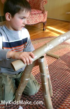 Make a telescope out of cardboard tubes and tin foil!
