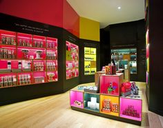 Italian studio Metroarea has designed Illyteca in Illy home city Trieste, a prototype of a new colourful series of shop to be built worldwide