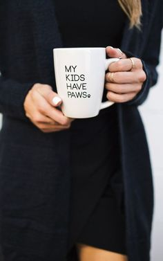Calling all animal lovers! Our My Kids Have Paws Mug is perfect for you. Sip your morning coffee in our My Kids Have Paws Mug while snuggling up with your furry friend. Our white mug features black te