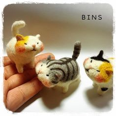 Needle felted cats. Different type of cat face with chubby cheeks.