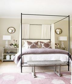 I just like the simplicity here. Love the mirrors. Atlanta Homes Mag Beautiful purple bedroom design with soft tan walls paint color, iron canopy Oly Studio Marco Bed, purple blanket, purple pillows, Madeline Weinrib Atelier Lilac Song Rug. Purple Bedroom Design, Lilac Bedroom, Pretty Bedroom, Bedroom Designs, Serene Bedroom, Feminine Bedroom, Stylish Bedroom, Bedroom Colors, Home Bedroom