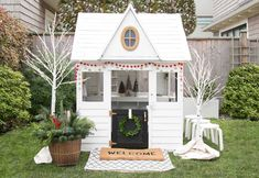 Kids wooden playhouse decorated for Christmas