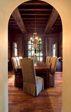 Spanish Colonial home. Beautiful woodwork and archway!