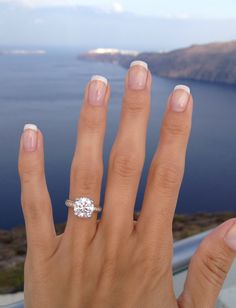 This girl's ring is AMAZING. Love the diamond not the band so much. Moisonite Engagement Rings, Cushion Cut Engagement Rings, Wedding Ring Cushion, Most Beautiful Engagement Rings, Wedding Engagement, Solitaire Cushion Cut, Cushion Cut Rings, Cushion Halo, Dream Ring