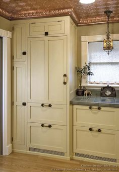 #Kitchen Idea of the Day: A Victorian kitchen featuring a copper ceiling and a panelized refrigerator. Victorian kitchens. (By Crown Point Cabinetry). Very lovely, antique white copper ceiling panelized refrigerator