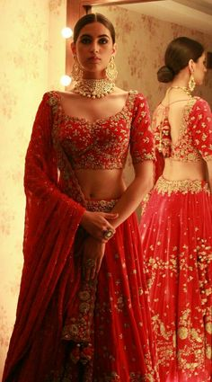 Looking for Bright Red Bridal Lehenga with Simple Gold Zardozi Work? Browse of latest bridal photos, lehenga & jewelry designs, decor ideas, etc. on WedMeGood Gallery. Indian Bridal Outfits, Indian Bridal Lehenga, Indian Bridal Wear, Indian Dresses, Bridal Dresses, Indian Wedding Dresses, Lehenga Wedding Bridal, Indian Weddings, Indian Outfits Modern