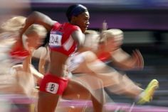 Kellie Wells of the U.S. competes during her women's 100m hurdles round 1 heat during the London 2012 Olympic Games.