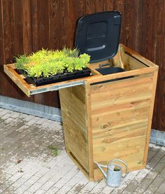 Hide ugly rubbish bins with this wheelie bin cover and sliding planter tray.