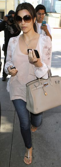 Who made Kim Kardashian's brown sunglasses, tan tote handbag, and sheer print top that she wore in Beverly Hills on March 27, 2012?