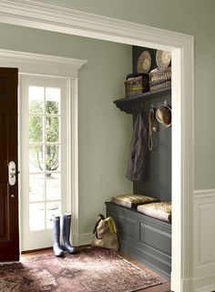 An inviting hallway in soft green and charcoal colors. Benjamin Moore 1495, OC-29, HC-166
