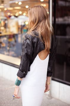 white dress and cropped leather jacket