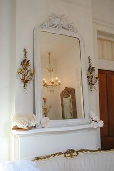 oooooh ....want these sconces...chandy in reflection of mirror...okay..will take it all