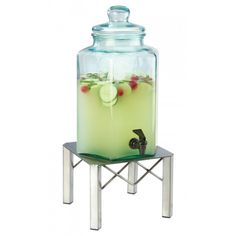 Industrial Beverage Dispensers Item: 3421-2. Serve your chilled beverages in style with this modern Industrial Glass Infusion Beverage Dispenser featuring a polished metal base and green glass dispenser. Perfect for restaurants, coffee shops, hotels, catered events, and more!