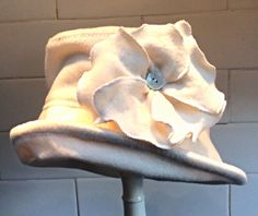 Wool hat with poppy trim by Lojango Design. Listed on Etsy