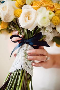 lace w/ buttons around bouquet stem & you could do the ribbon in the accent color of wedding