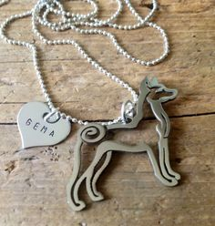 By artist tagsoup on Etsy... I'd need to add a heart so I can name both of our basenjis, of course... https://www.etsy.com/listing/214462807/add-on-stainless-steel-heart-tag-custom?ref=shop_home_active_7&ga_search_query=add-on