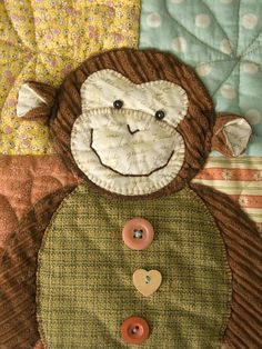 It's a Monkey. For this I will learn to applique. By Laurraine Yuyama, Patchwork Pottery.