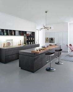 Modern Living by Leicht I like the rough wooden accent piece on the island