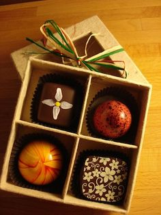 Escazu Artisan Chocolates in Charlotte, NC using our Distant Village candy boxes.