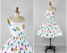 vintage 1950s dress / 60s dress / White, Purple, Teal, and Green Floral Print Tulips Sundress. $168.00, via Etsy.