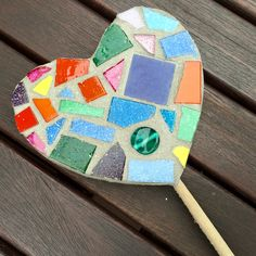 Handmade mosaic wooden heart stick incorporating multi-coloured design. Made from glass tiles and beads.