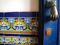 Moorish designs: tile, brass door knocker