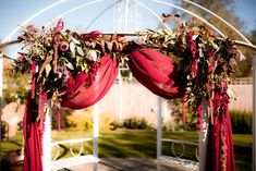 Rich jewel tones of trailing amaranthus, astilbe, astrantia and pink ice protea with seasonal foliage including hydrangea, populus leaf and leucodendron bring this gorgeously opulent flower arch to life in the wedding garden at Applewood Hall. Unique Wedding Venues, Unique Weddings, Bridal Shoot, Wedding Shoot, All Inclusive Wedding Packages, Warm Colour Palette, Wedding Brochure, Outdoor Wedding Inspiration, Maroon Wedding