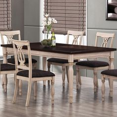 """Dining table with fluted turned legs.  Product: Dining tableConstruction Material: WoodColor: Antique white and merlotFeatures: Smooth polished edgeDimensions: 30.25"""" H x 70.75"""" W x 39.25"""" D Note:  Chairs not included"""