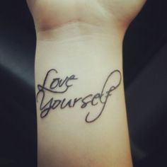 Love yourself tattoo on the wrist