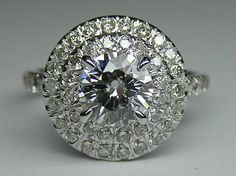 Engagement Ring - Round Diamond Cathedral Double Halo Engagement Ring with Accents..wow quite the diamond!!