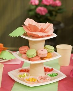 Tiered Paper Candy Stand-simple and can be thrown away after the shower. Hobby Lobby has great plates and cups for this.
