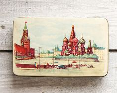 This is a 1960s vintage USSR Soviet Russian candy tin box depicting Kremlin, Red Square in Moscow. Size:  4.13 x 6.7 x 1.57 inches)  (10.5 x